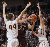 DARIN EPPERLY/DAILY NEWS LINCOLN -- Luke Kluver of Norfolk takes a shot as Hayden Bahl (44) and Peyton Priest of Papillion-LaVista during the Class A championship game on Saturday night at Pinnacle Bank Arena. Bahl fouled Kluver on the play. 3-11-17