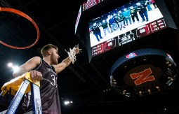 DARIN EPPERLY/DAILY NEWS LINCOLN -- Logan Strom of Norfolk holds the net up after the Panthers won the Class A championship game on Saturday night at Pinnacle Bank Arena. 3-11-17