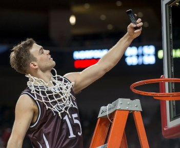 DARIN EPPERLY/DAILY NEWS LINCOLN -- Lane McCallum of Norfolk takes a selfie after cutting down the net after they defeated Papillion-LaVista during the Class A championship game on Saturday night at Pinnacle Bank Arena. 3-11-17