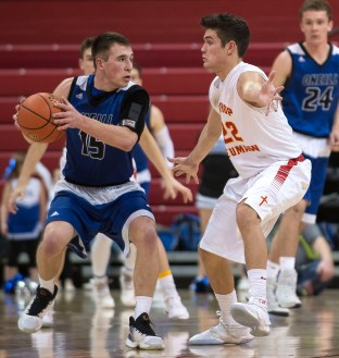 DARIN EPPERLY/DAILY NEWS LINCOLN -- Jake Young of O'Neill keeps the ball from Bishop Neumann's Noah Vedral during their first round game at the Devaney Sports Center in Lincoln on Thursday afternoon. 3-9-17