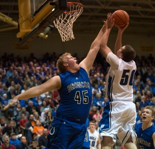 DARIN EPPERLY/DAILY NEWS LINCOLN -- Jack Charlson of Ponca puts up a shot as Justin Heine of Centennial defends during their first round game at Lincoln Southeast on Thursday night in Lincoln. 3-9-17