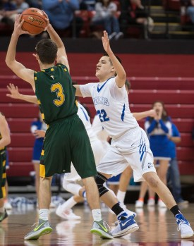 DARIN EPPERLY/DAILY NEWS LINCOLN -- MaNaPe Cleveland of Winnebago guards John Husmann of Kearney Catholic during their first round game at the Devaney Sports Center on Thursday morning in Lincoln. 3-9-17