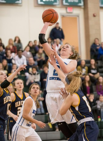 DARIN EPPERLY/DAILY NEWS LINCOLN -- Caitlin Orton of North Central shoots over Taylor Goedert of Elm Creek during their first round Class D1 game at Lincoln Southwest on Thursday. 3-2-17