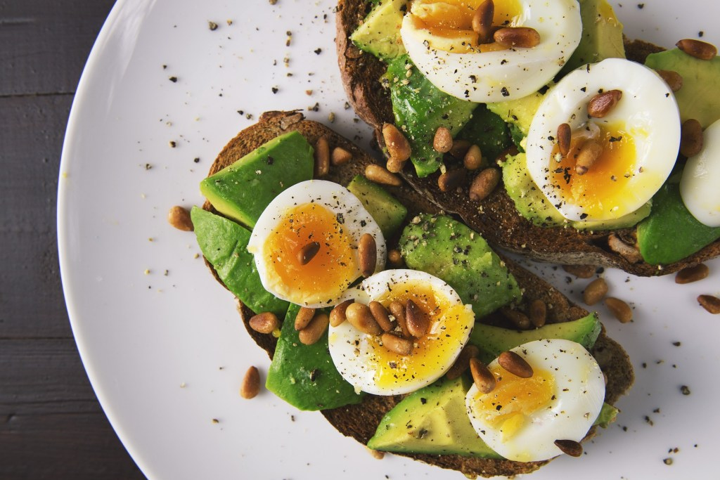 avocado toast with eggs is an easy lunch or snack to make while traveling