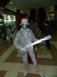 Живая статуя Бродячий музыкант