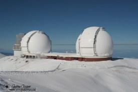 Fresh snowfall drapes the telescopes in white