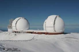 Fresh snowfall drapes the telescopes in white