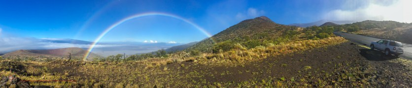 A fogbow formed from drifting fog blowing across the Mauna Kea access road. Click on the image to peruse the panorama properly.