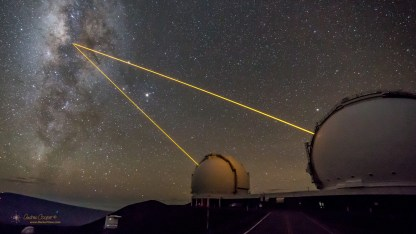 A pair of AO lasers used to observe the central region of the Milky Way Galaxy emerge from Keck 1 and Keck 2