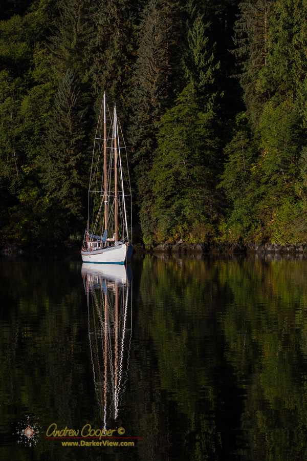 The sailboat Passing Cloud at anchor in Khutze Inlet