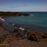 A black sand beach south of Kiholo Bay