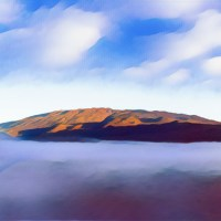 Mauna Kea sits above a fog shrouded Saddle Road