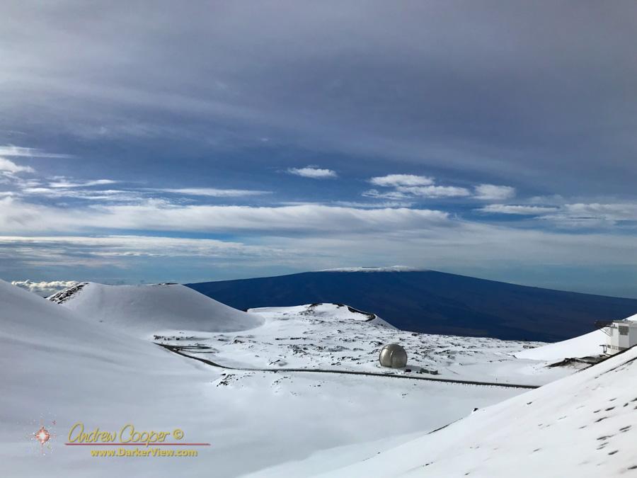 Fresh snow blankets the summit of Mauna Kea and the distant Mauna Loa