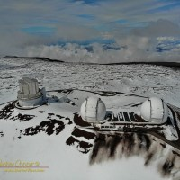 Keck and Subaru in the snow atop the summit of Mauna Kea