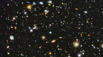 "Astronomers using NASA's Hubble Space Telescope have assembled a comprehensive picture of the evolving universe ? among the most colorful deep space images ever captured by the 24-year-old telescope. Researchers say the image, from a new study called the Ultraviolet Coverage of the Hubble Ultra Deep Field, provides the missing link in star formation. The Hubble Ultra Deep Field 2014 image is a composite of separate exposures taken in 2002 to 2012 with Hubble's Advanced Camera for Surveys and Wide Field Camera 3. Astronomers previously studied the Hubble Ultra Deep Field (HUDF) in visible and near-infrared light in a series of images captured from 2003 to 2009. The HUDF shows a small section of space in the southern-hemisphere constellation Fornax. Now, using ultraviolet light, astronomers have combined the full range of colors available to Hubble, stretching all the way from ultraviolet to near-infrared light. The resulting image - made from 841 orbits of telescope viewing time - contains approximately 10,000 galaxies, extending back in time to within a few hundred million years of the big bang. Prior to the Ultraviolet Coverage of the Hubble Ultra Deep Field study of the universe, astronomers were in a curious position. Missions such as NASA's Galaxy Evolution Explorer (GALEX) observatory, which operated from 2003 to 2013, provided significant knowledge of star formation in nearby galaxies. Using Hubble's near-infrared capability, researchers also studied star birth in the most distant galaxies, which appear to us in their most primitive stages due to the significant amount of time required for the light of distant stars to travel into a visible range. But for the period in between, when most of the stars in the universe were born - a distance extending from about 5 billion to 10 billion light-years - they did not have enough data. ""The lack of information from ultraviolet light made studying galaxies in the HUDF like trying to understand the history of families wi"