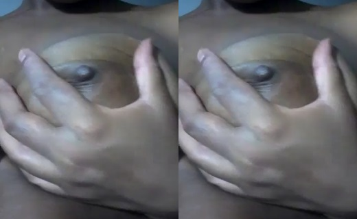 Horny Nigerian Girl Squeezing Her Boobs