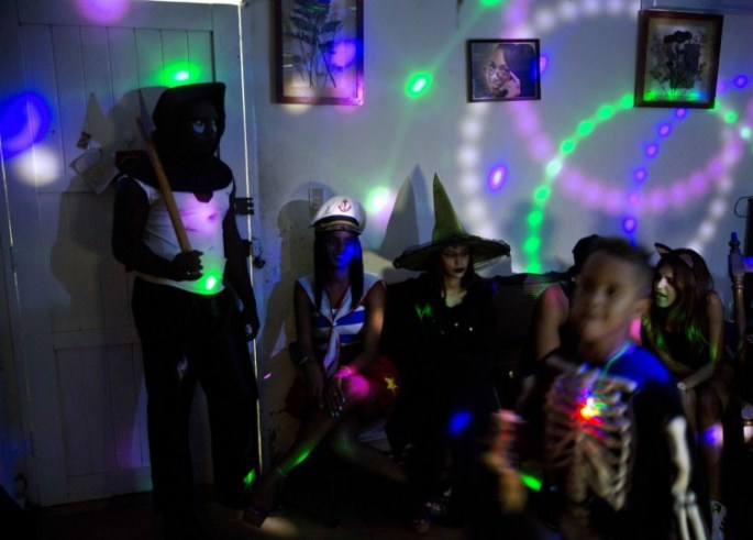 Youth in costumes attend a Halloween party at a home in Havana, Cuba, Friday, Oct. 28, 2016. The costumes ranged from expensive imported rented outfits to handmade costumes cobbled together from items found around the house. (AP Photo/Ramon Espinosa)