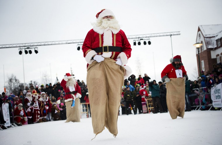 Estonian Santa Claus 'Santa Aare' (L), Dutch Santa Claus 'Santa Holland' (C) and Swedish Santa Claus 'Snaretomten' compete in the Kicksled Sack Race during the Santa Clause Winter Games in Gallivare, above the polar circle in northern Sweden on November 17, 2012. (Jonathan Nackstrand/AFP/Getty Images)