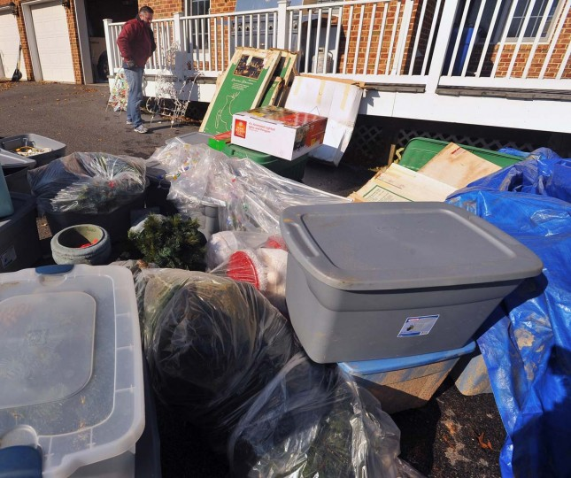 """A large pile of assortment decorations and ornaments provided by the home owner will be used by """"The King of Christmas"""" along with additional materials the company provides to decorate this Timonium home. (Gene Sweeney Jr./Baltimore Sun)"""