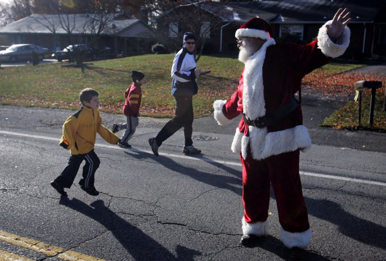 Santa Claus, played by Joe Marks of Ellicott City, directs runners participating in the 6th Annual Reindeer Run in memory of Tom Lisenmeyer at the West Laurel Community Building in Laurel, Maryland, on November 24, 2007. (Jason Fritz/Patuxent Publishing)
