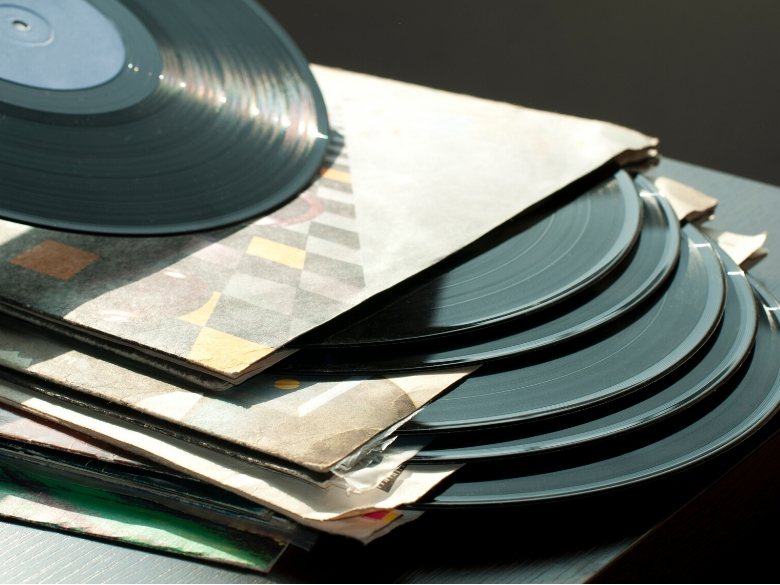 Stack of dirty records to be cleaned by hand