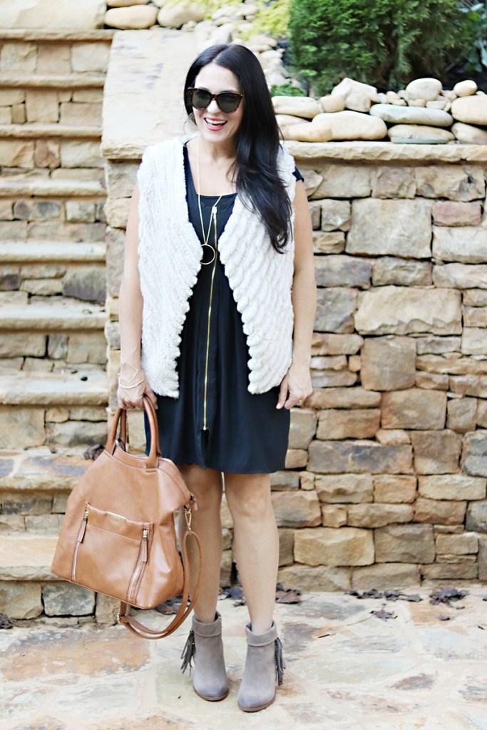 fur-vest-black-dress-brown-bag