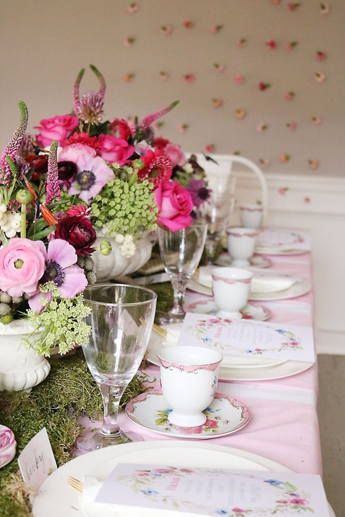 garden-tea-party-with-flower-wall, garden-tea-party-inside, garden tea party, outside garden party, table decorations, flowers, flower arrangements, butterfly, whimiscal, Alice in Wonderland, english tea party, centerpieces, secret garden