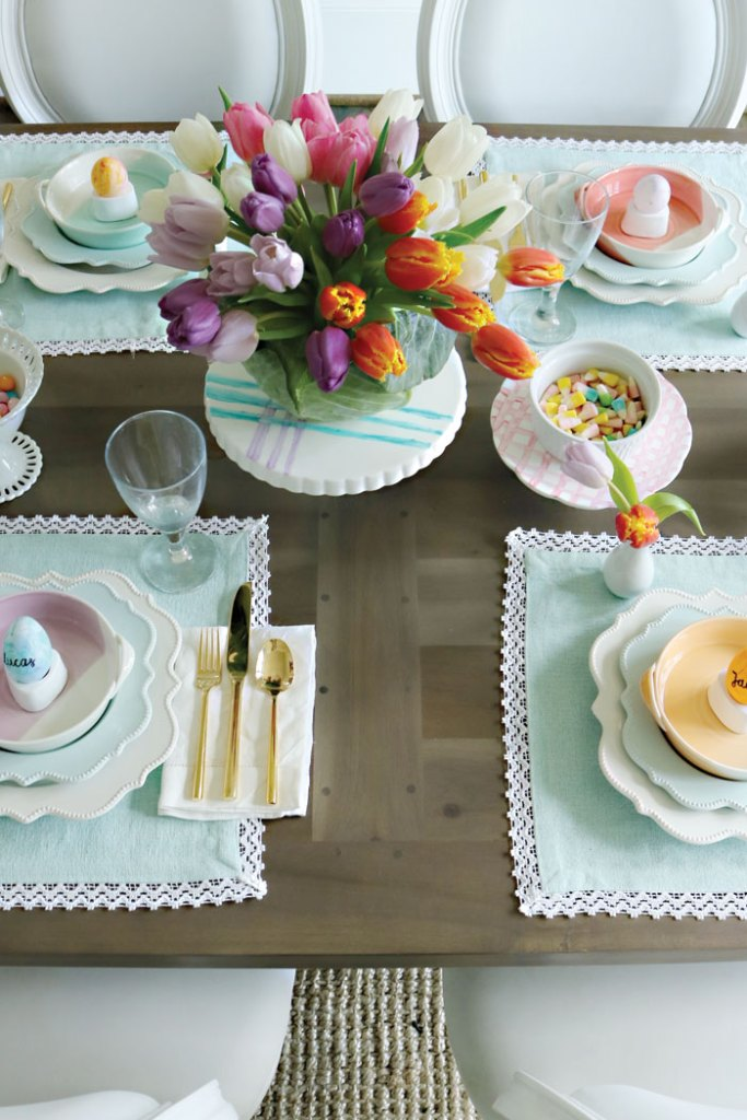 pastel-colored-easter-table-with-tulips, Easter-table-decorations, spring easter table decorations, easter tablescapes, easter table settings, DIY easter, simple easter table, easter centerpieces, ideas, christian, spring, cheap, cute fun easter place settings