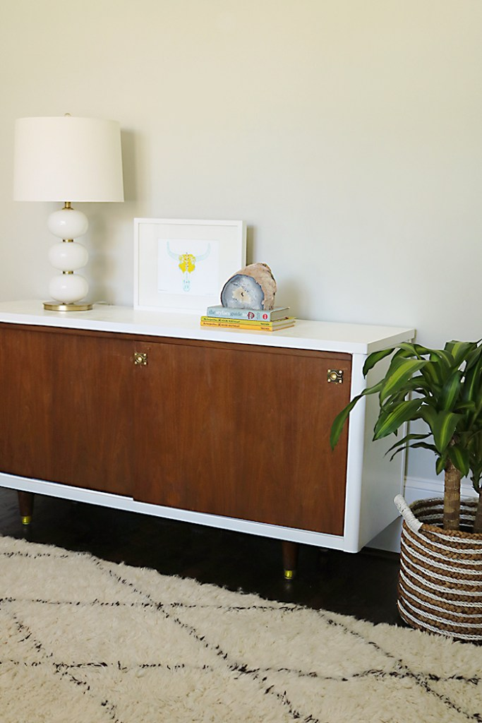 mid century credenza with white shag rug