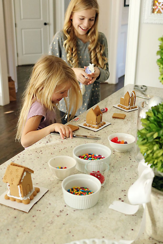 christmas-decorations-gingerbread-houses-laughing-girls