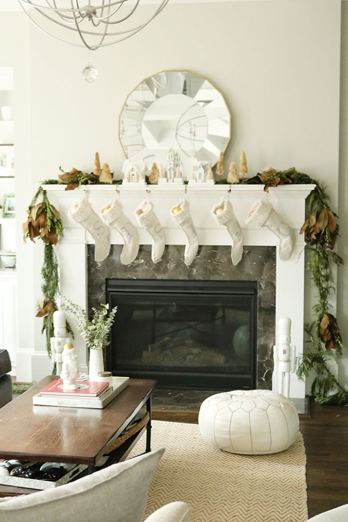 christmas-decorations-living-room-shot, fireplace mantle christmas decorations, magnolia garland, winter white christmas, living room christmas decorations