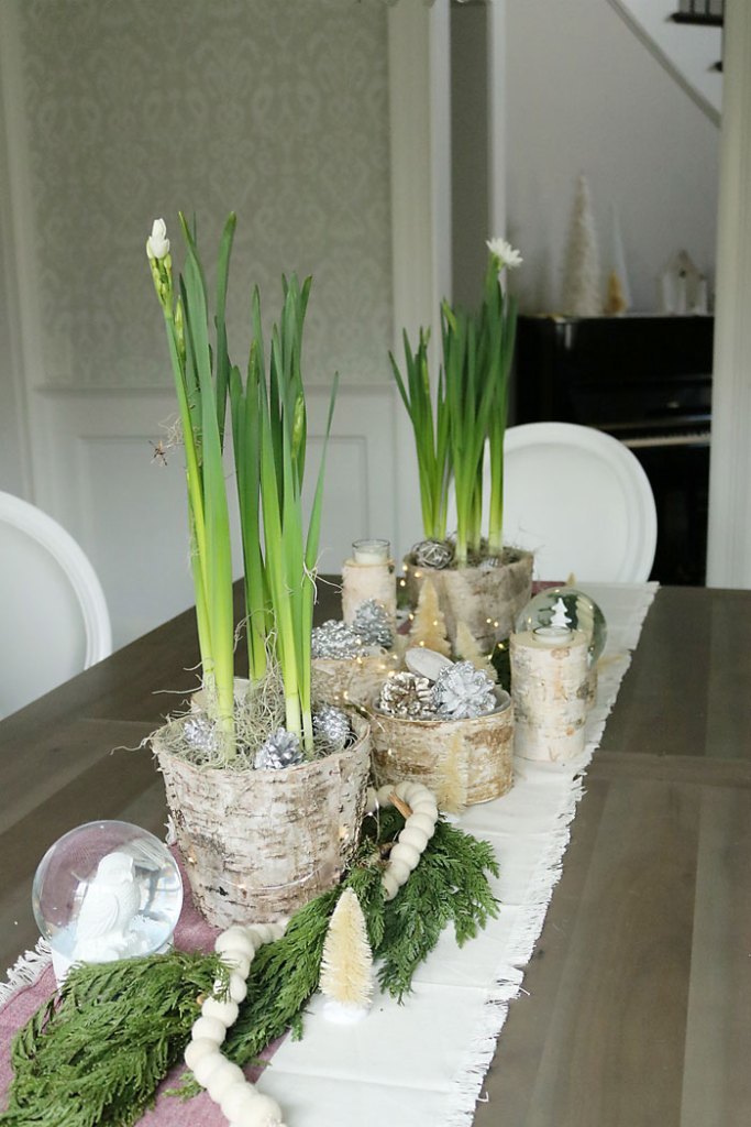 christmas-paperwhites-table-centerpiece, christmas-decorations-living-room-shot, fireplace mantle christmas decorations, magnolia garland, winter white christmas, living room christmas decorations, paperwhite decorations, dining room centerpiece