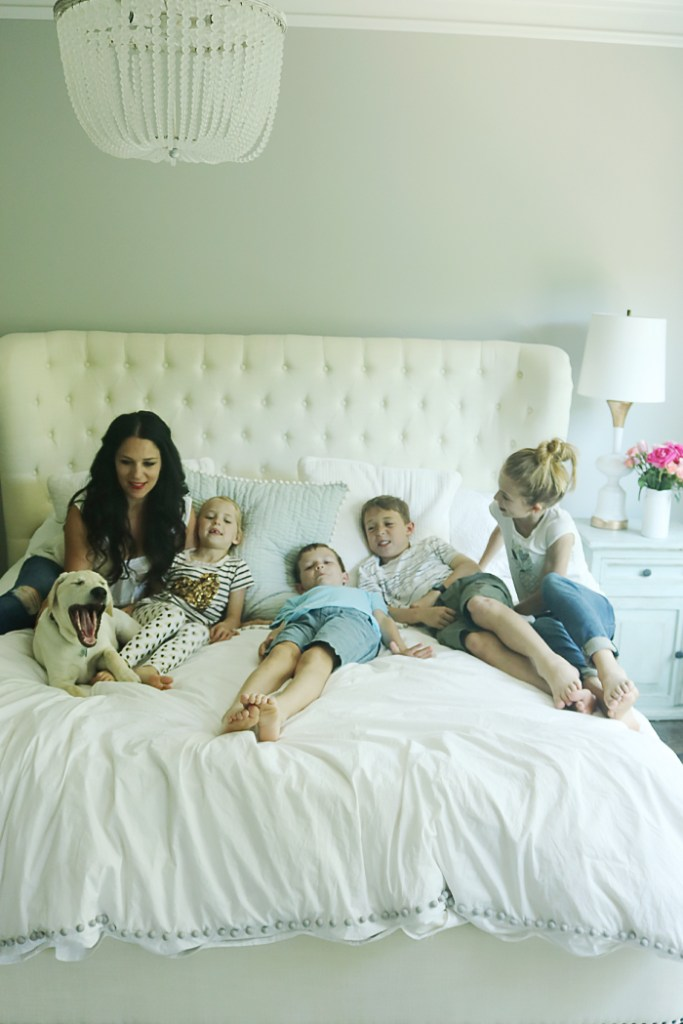 family bed, family bed photography, mother's day, candid moments, family pictures on bed, mother's day pictures, white bed with kids