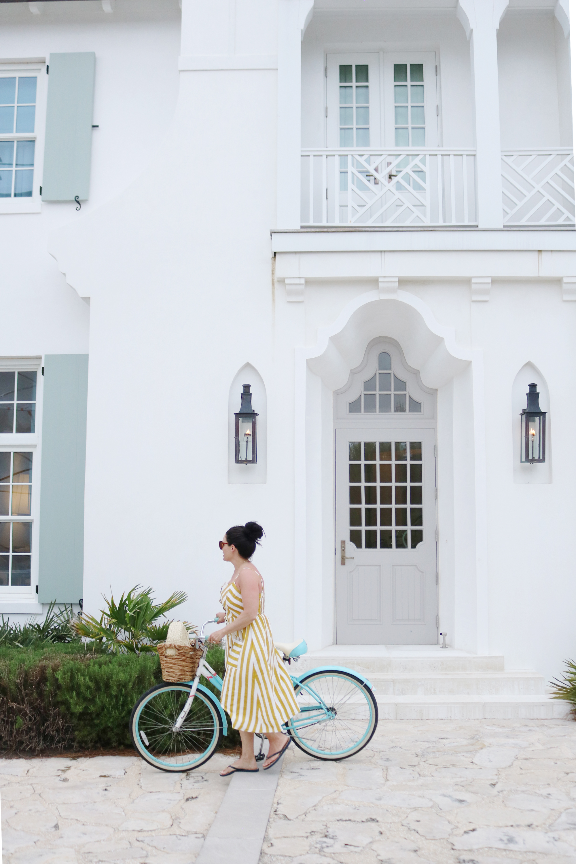 Biking around Alys Beach in my yellow striped button up dress, what beach vacation maxi dress to pack || Darling Darleen