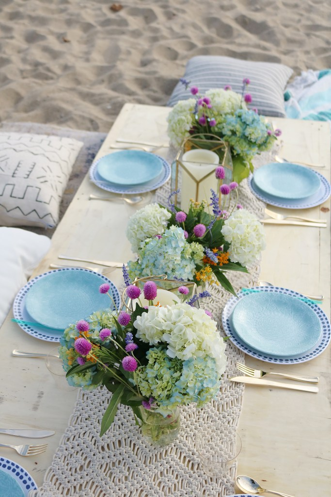 Boho Birthday Beach dinner with pillows and vintage rugs.  Set up plates and table decor on pallet and add pillows.  Birthday Beach dinner idea, beach dinner casual || Darling Darleen