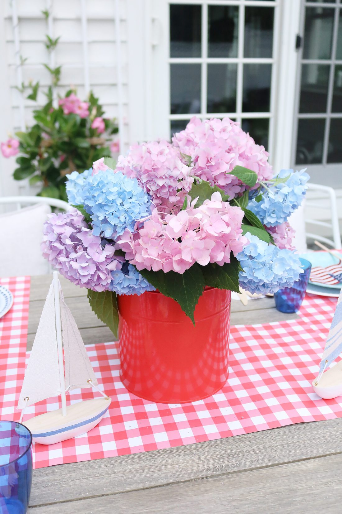 4th of july flower hydrangea arrangement.  This year host a 4th of July barbecue party and sharing simple budget-friendly decorating tips, 4th of July outfit, red gingham dress, 4th of July entertaining tips, american flag decorations, backyard party, 4th of july tablescape  || Darling Darleen Top CT Lifestyle Blogger #4thofjuly #4thofjulyoutfit