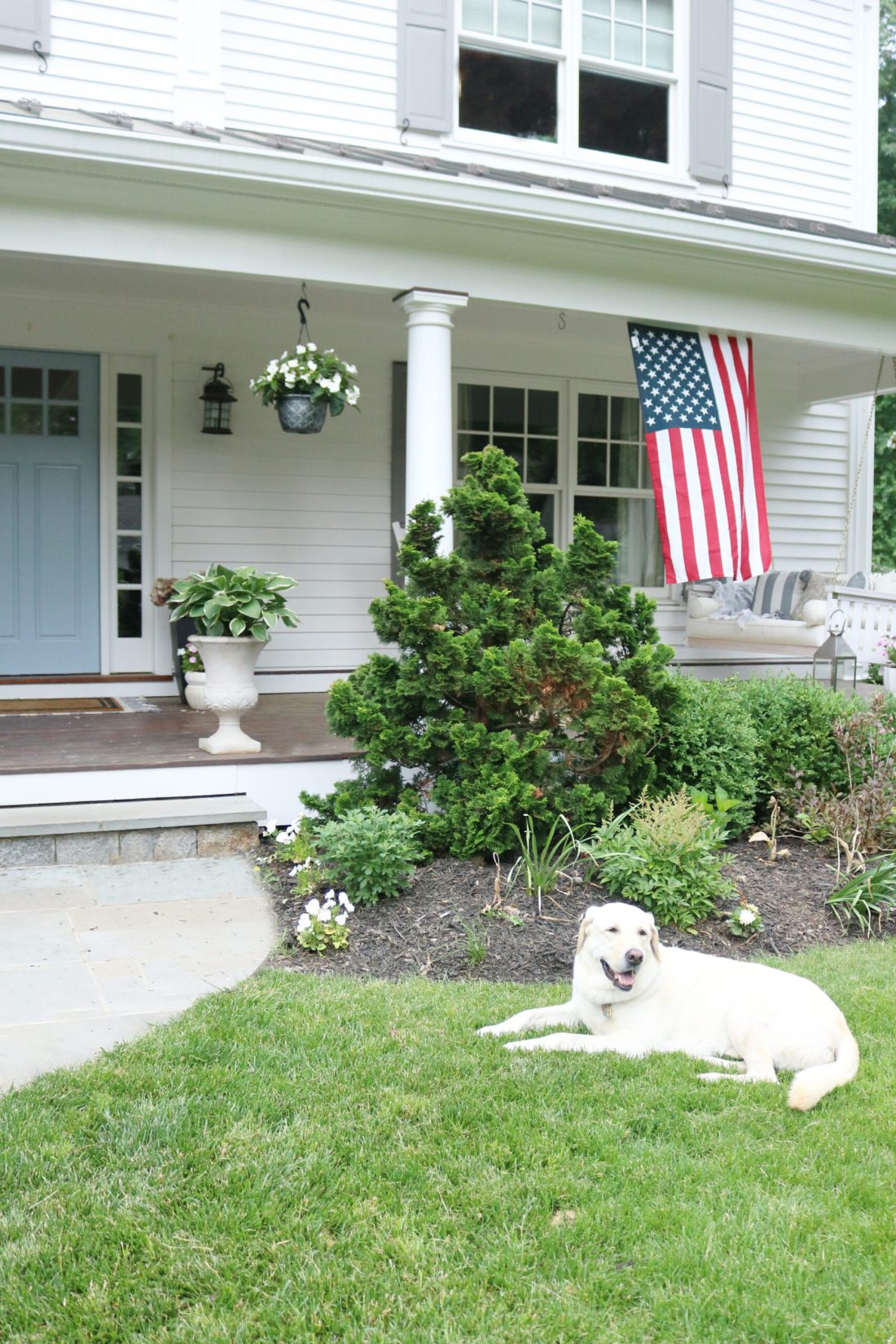 A beautiful home exterior can make or break curb appeal! Sharing 7 easy and simple curb appeal ideas || Darling Darleen Top CT Lifestyle Blogger home exterior | outdoor charm | curb appeal ideas | home exterior ideas | white house with gray shutters | porch swing | shutter | new england charm | blue front door | #darlingdarleen