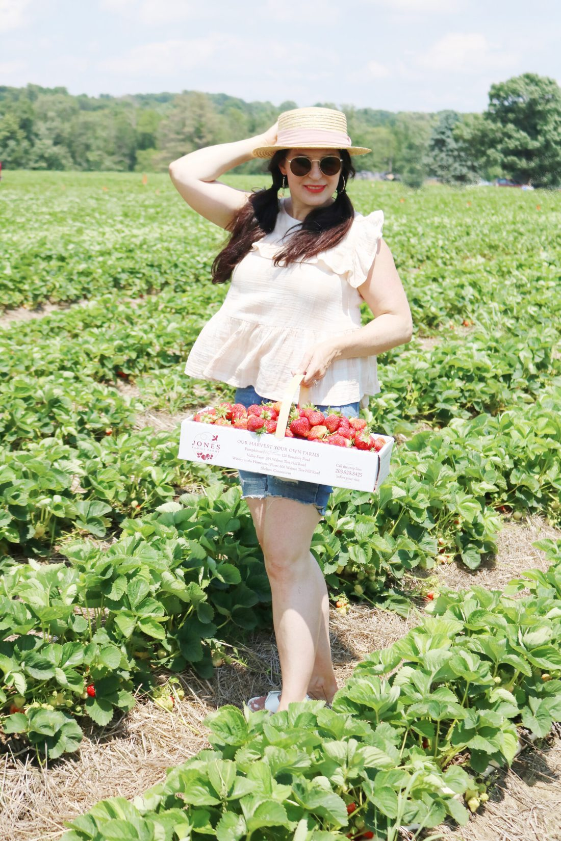 What to wear when picking strawberries? Make sure to wear a hat, flowy clothes to stay cool and easily bend down and open toe sandals that are okay to get dirty and wet || Darleen Meier Top Lifestyle CT Blogger #strawberryfieldsforever #darlingdarleen
