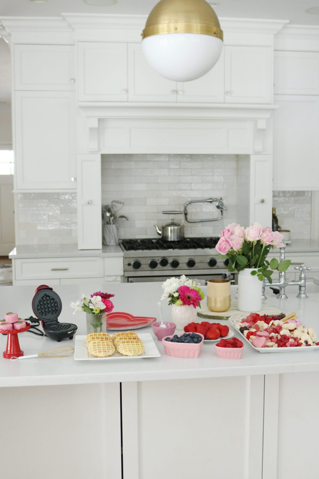 Bring Valentine's Day Home this year!  Put together a Valentine's waffle bar and breakfast of hearts and a charcuterie board with heart shaped chocolate, cinnamon lips and macrons!  So many fun Valentine's Day ideas to share with your family || Darling Darleen Top Lifestyle Blogger #ctblogger #darlingdarleen #valentinesday