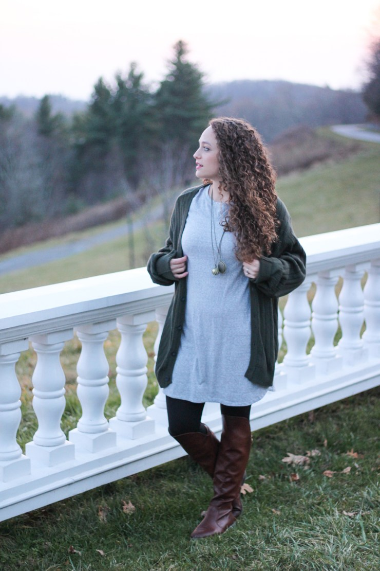 oversized cardigan with a shift dress, leggings, and otk boots