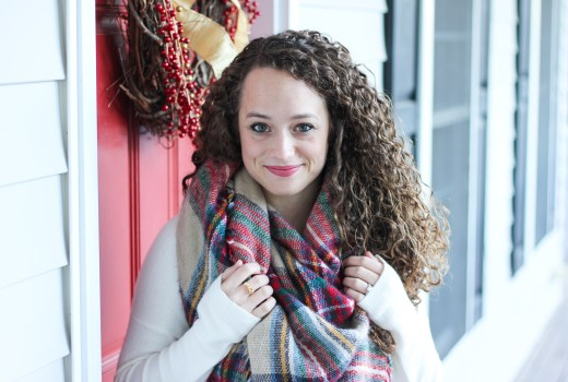 Tartan plaid blanket scarf with a white sweater and green fair isle boot socks