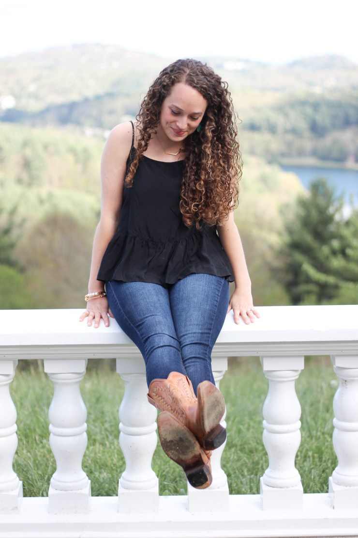 Black tank top, jeans, and cowboy boots for the perfect summer look!