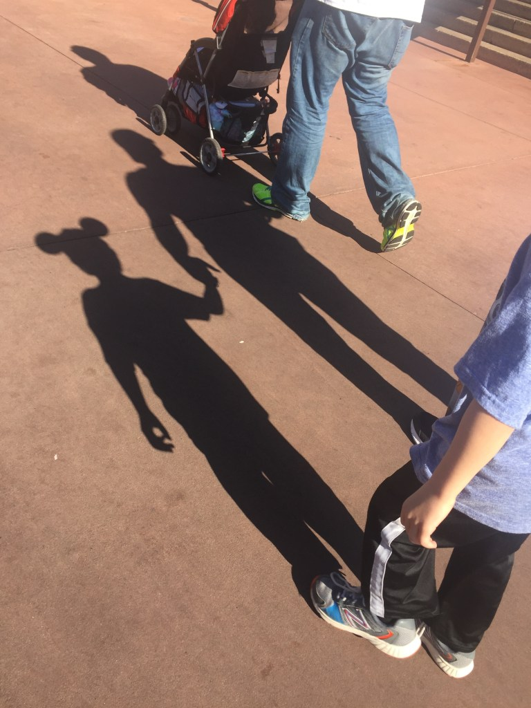 Mickey Mouse ears shadow on the ground