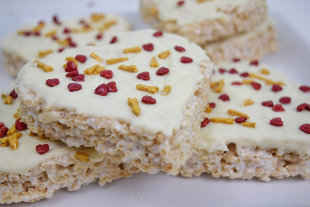Frosted Valentine Rice Krispie Treats on a tray closeup