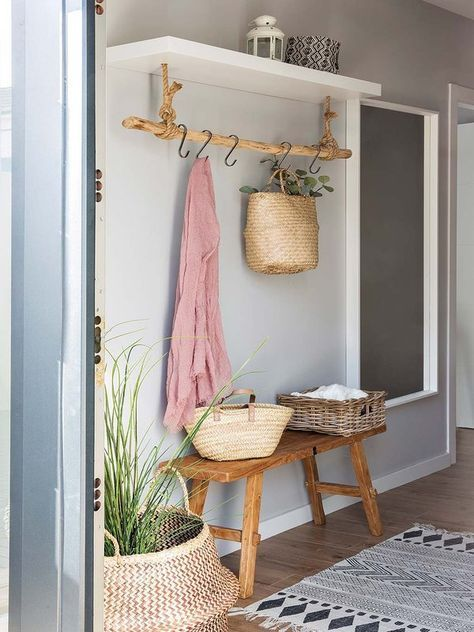 Hallway with a bench and a hanging rod with hooks