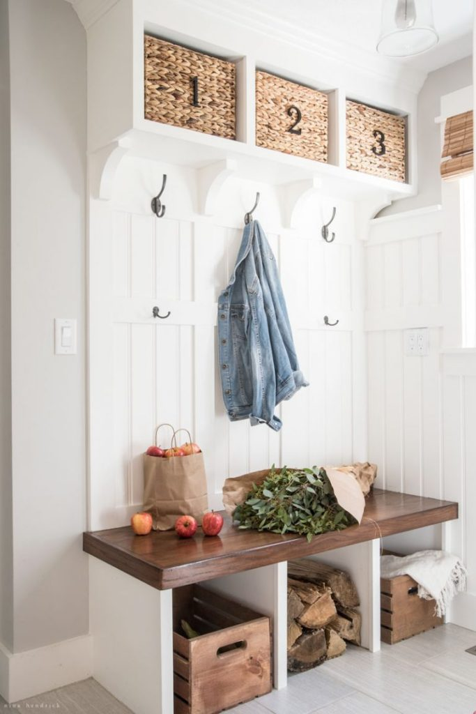 Mudroom storage with a bench and built-in cubbies below