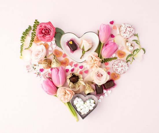 heart shaped arrangement on pink background