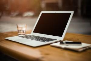 Macbook open on a beautiful desk.