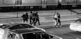 Young protesters being removed from the west-bound 290 expressway.