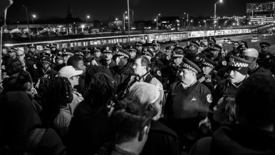Protesters confront Chicago Police.